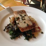 Curried Lemon Caper Sauce over a Pan Seared Salmon with Mushrooms and Kale